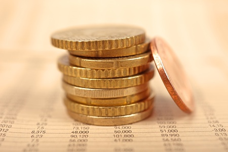 Macro of euro coins and financial newspaper. photo