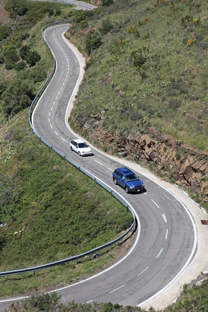 Serpentine road in Pyrenees, borderland of France and Spain, Mediterranean Europe. Stock Photo