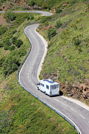 Camper on the road near border between Spain and France. Banque d'images