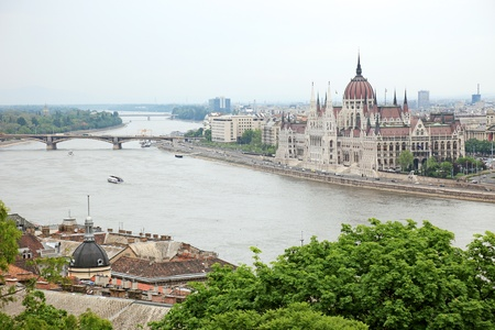 Parliament of Hungary on the riverside of Danube river, Budapest cityscape. photo
