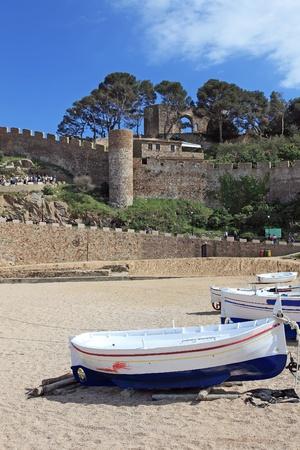 Boats on the beach in Tossa de Mar, Costa Brava, Spain. photo