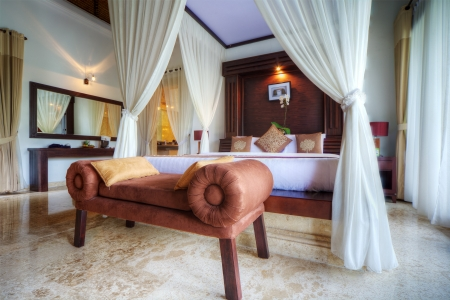 Luxury tropical villa bedroom, Bali, Indonesia.