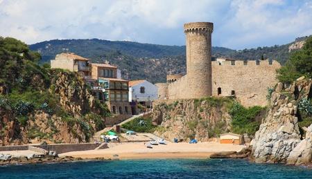 Castle in Tossa de Mar, view from sea, Costa Brava, Spain. photo