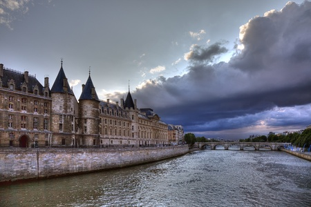 Conciergerie before rain in Paris, dramatic cloudscape. photo