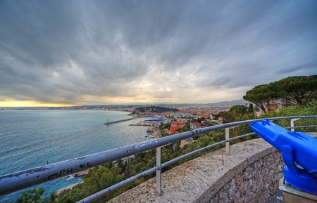 Wide angle panoramic view of harbor of Nice city, France. Dramatic sky before sunset during springtime. photo