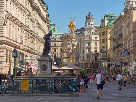 plague: VIENNA, AUSTRIA - JULY 16: People is walking in Graben street Grabenstrasse, main street in old town of Vienna. The column, called The Pestsule Plague column was built in 1693 after epidemics. Editorial