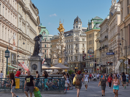 main street: VIENNA, AUSTRIA - JULY 16: People is walking in Graben street Grabenstrasse, main street in old town of Vienna. The column, called The Pestsule Plague column was built in 1693 after epidemics. Editorial