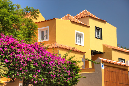Classical spanish villa among flowers, not far from ocean. Tenerife, Spain.