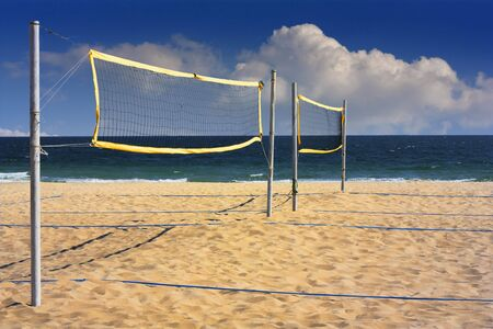 Beach volleyball net at the end of summer photo