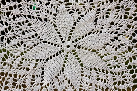 Beautiful  white crochet tablecloth for background.  photo