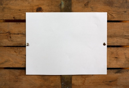 piece of blank paper tacked to wooden background.Ready for your text  photo