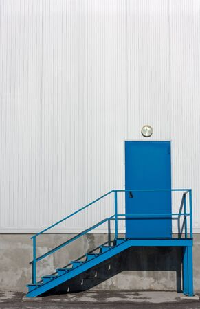 metallic stairs: Blue,metal warehouse entry door with stairs Stock Photo