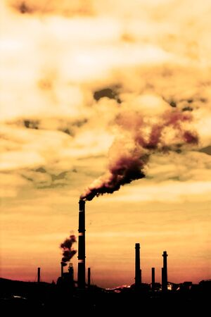 Global warming concept in sepia.Pollution smoke from factory photo