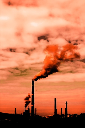 Global warming concept.Smoke rising from factory photo