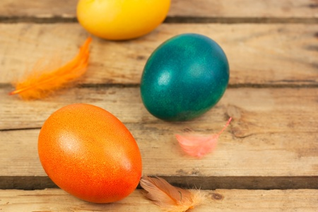 Three easter eggs on wooden floor photo