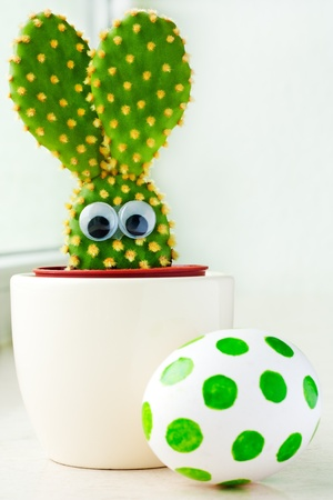 Closeup of a small cactus in shape of a bunny and easter egg photo
