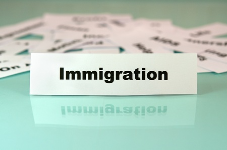 Piece of paper with immigration sign or word on it