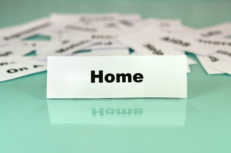Piece of paper with the word or sign home photo