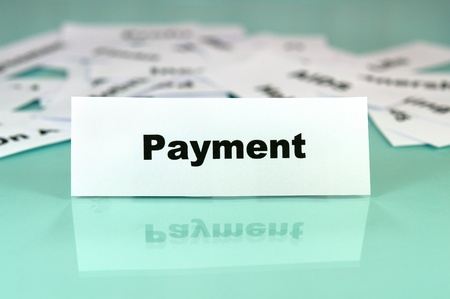 Piece of paper with payment word,sign or text on it photo