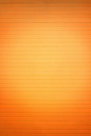 shutter door: Orange  closed garrage door background Stock Photo