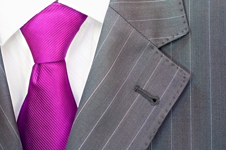 silk tie: Detail of a mens striped business suit.Pink tie and a shirt