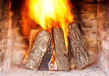 woodpile: Close image of fire in the fireplace