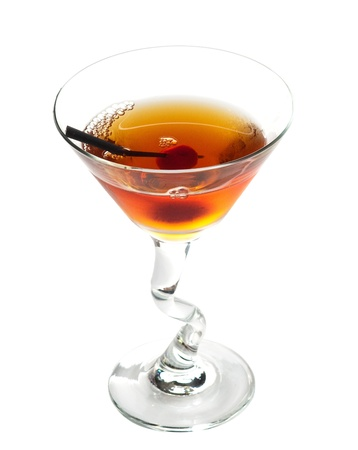 Manhattan cocktail on martini glass with Maraschino Cherrie isolated on white background photo