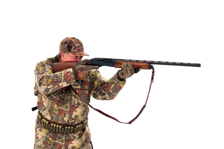 Male hunter in camouflage aiming at his target or prey with his gun.Isolated on white background photo
