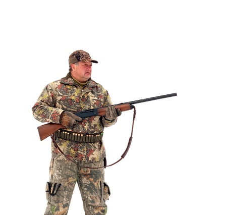 Male hunter in camouflage,holding his gun and looking for his target or prey .Isolated on white background photo