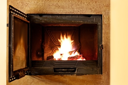Close image of fire in open fireplace photo