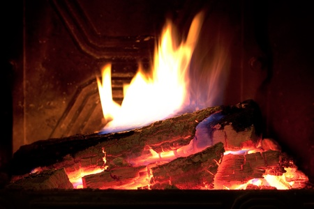 Close image of fire in the fireplace photo