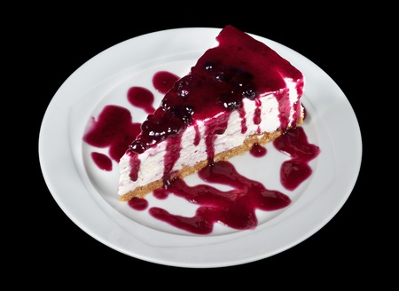 delectable: Blueberry Cheesecake isolated on black background