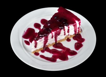 Blueberry Cheesecake isolated on black background