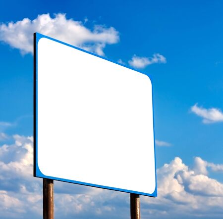 Blank  Road Sign Against Light Cloudscape, Summer Sky And Clouds photo