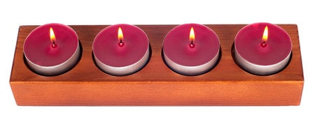 candleholder: Wooden candleholder or candlestick with four burning or flaming  candles isolated on white background