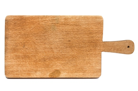Old heavily used chopping or cutting board on white background photo