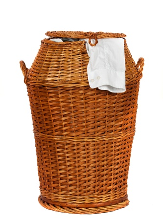 Wicker laundry basket or Hamper  over white background photo