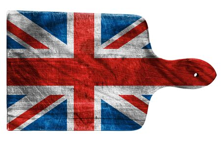 Textured British or UK  flag painted on old heavily used chopping or cutting board on white background photo