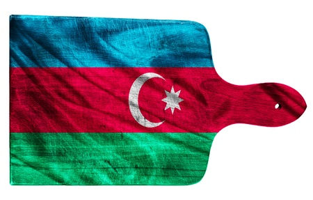 Textured  Azerbaijan  flag painted on old heavily used chopping or cutting board on white background photo