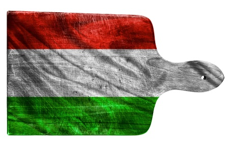 Textured Hungary flag painted on old heavily used chopping or cutting board on white background photo
