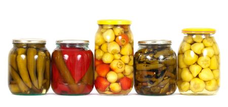 tinned: Glass jars with different kinds of preserved peppers Homemade tinned or canned food on white background