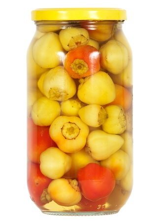 tinned: Glass jar with  preserved peppers Homemade tinned or canned food isolated on white background Stock Photo