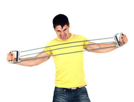 Young athletic man exercising and doing fitness with a chest expander(resistance band ).Isolated on white background  photo