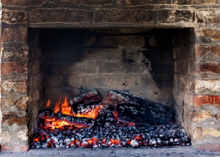 embers: Glow of embers preparing for outdoors charcoal-barbecuing in fireplace Stock Photo
