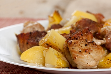 english cucumber: Roasted pork meat with baked potatoes Stock Photo
