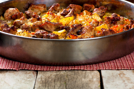Roasted pork meat with baked potatoes photo