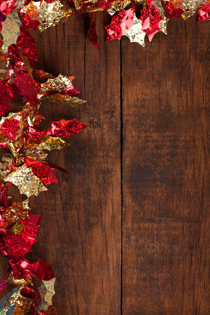 Christmas decoration.Christmas garland  on rustic dark wooden background.Copy space photo