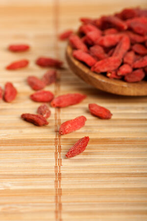 tibet bowls: Healthy food organic nutrition.Wooden tablespoon of dried goji berries