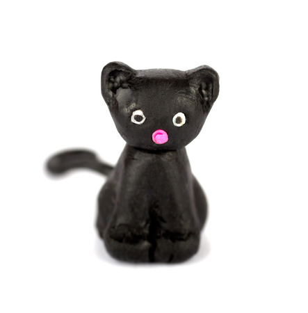 plastic made: Hand made plasticine or modeling clay figure of a cat on white background.Shallow DOF