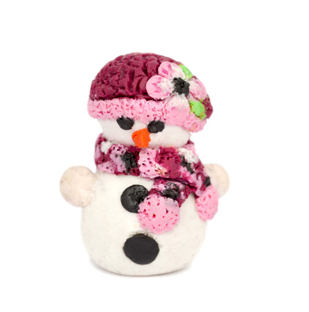 clay modeling: Hand made plasticine or modeling clay figure of snowman on white background.Christmas decoration